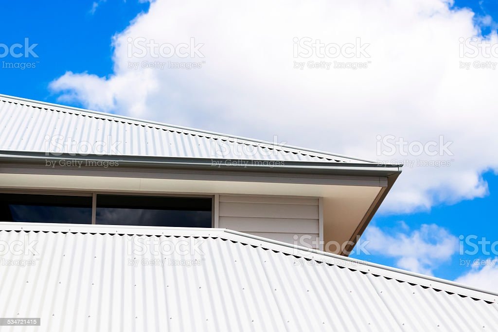 Low angle view of corrugated iron roof, copy space stock photo