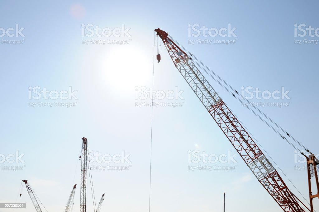 Low angle view of crane with Solar stock photo