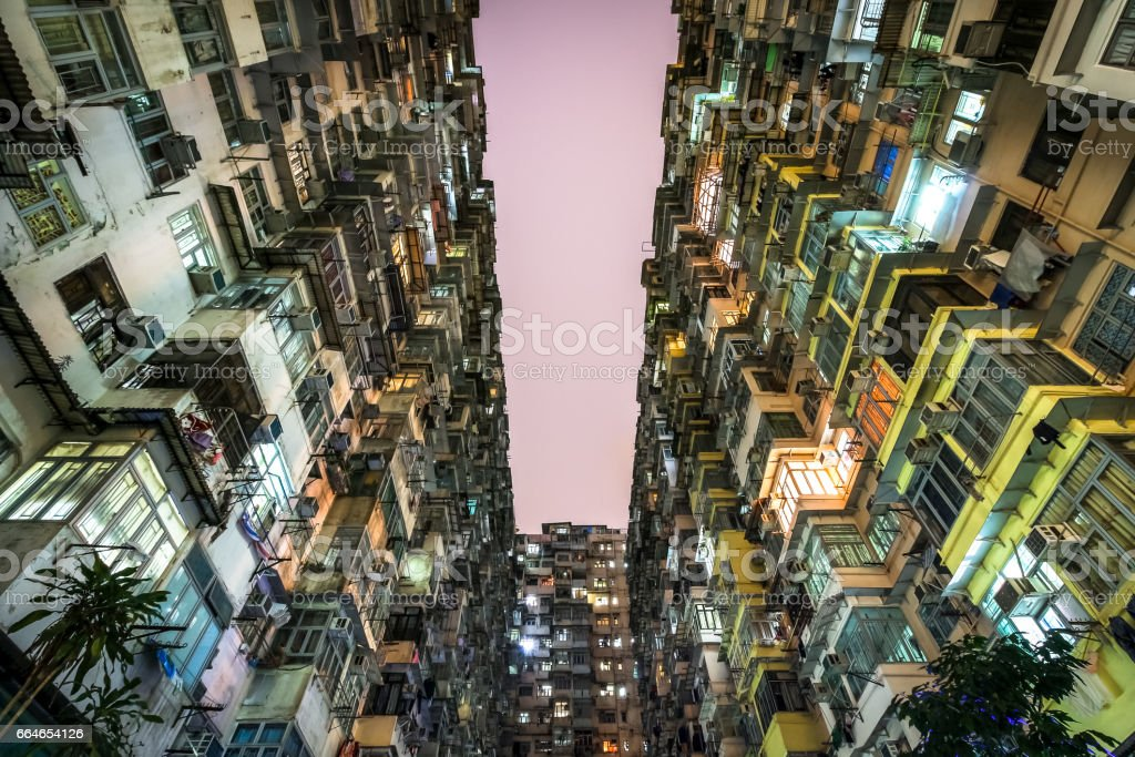 Low angle view of crowded residential towers in an old community in Quarry Bay, Hong Kong. Scenery of overcrowded narrow apartments, a phenomenon of high housing density & housing blues in Hongkong. stock photo