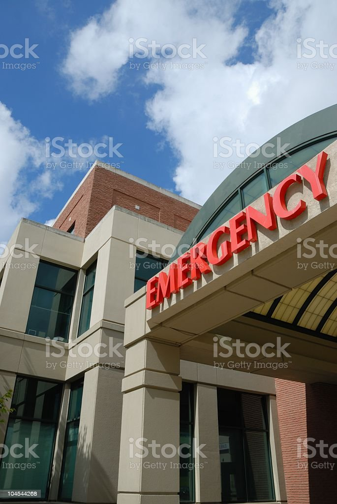 Low angle view of emergency room sign on building exterior stock photo