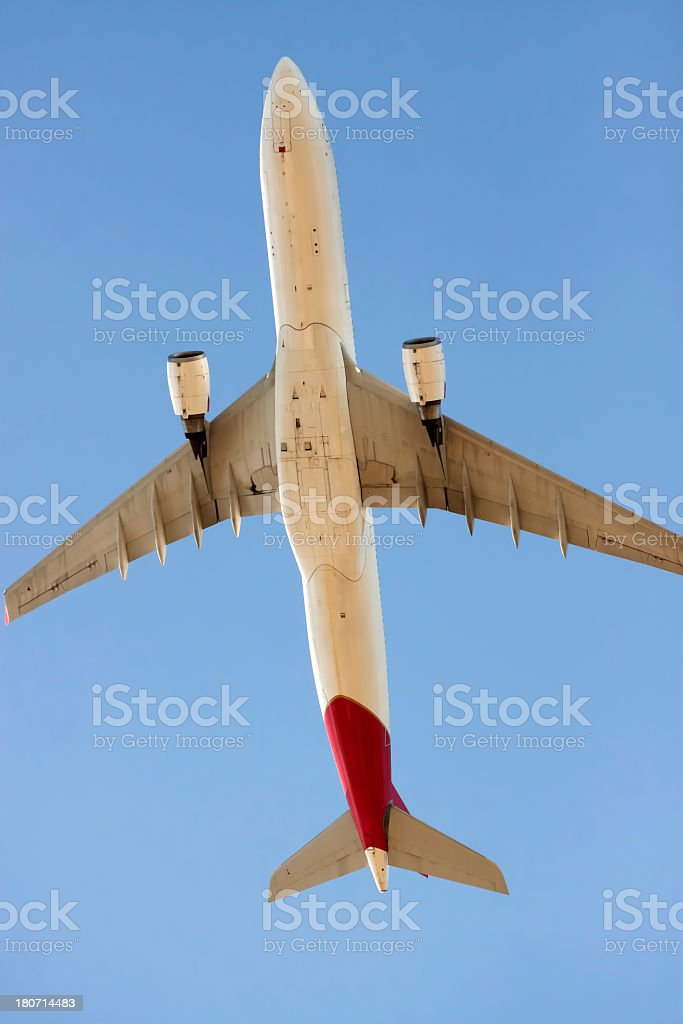 Low angle view of flying airplane against sky, copy space royalty-free stock photo