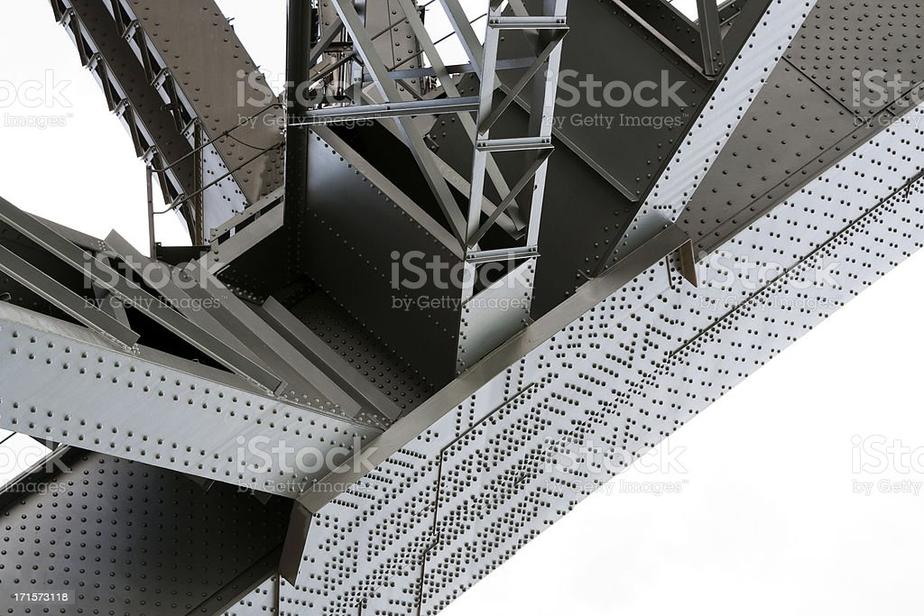 Low angle view of gigantic steel sturcture under the bridge stock photo