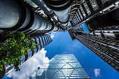 Low angle view of glass and steel towers, London, UK