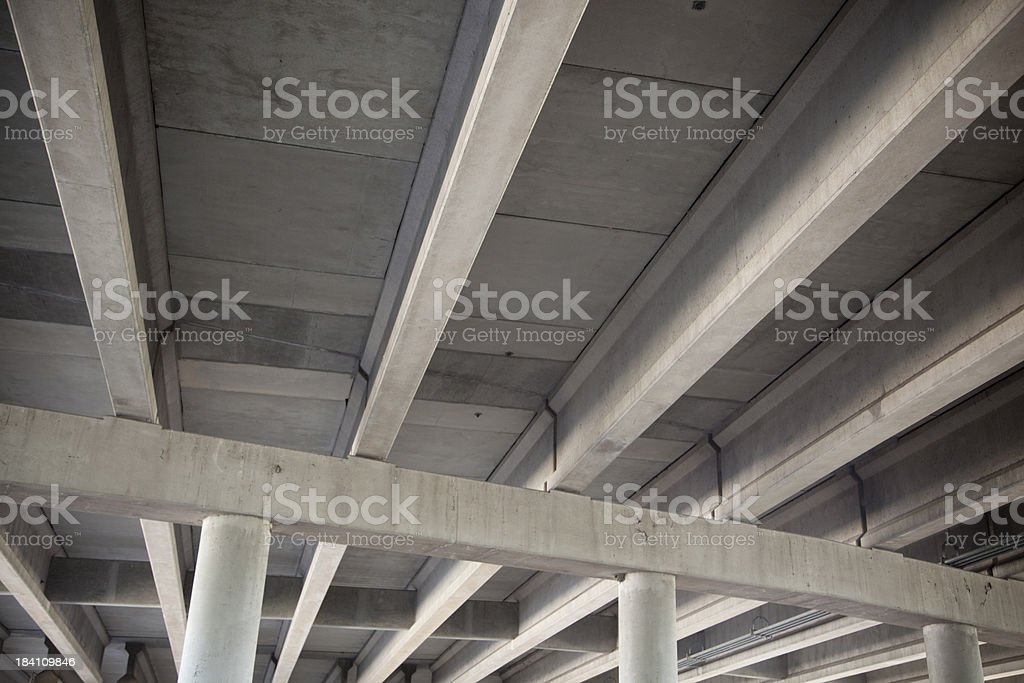 Low angle view of highway overpass with beams and columns stock photo