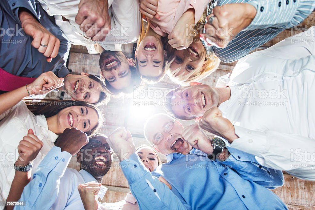 Low angle view of large group of successful business people. stock photo
