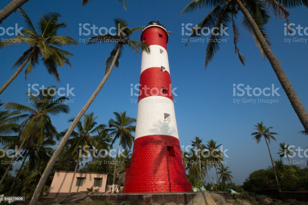 Low angle view of light house against blue sky. stock photo