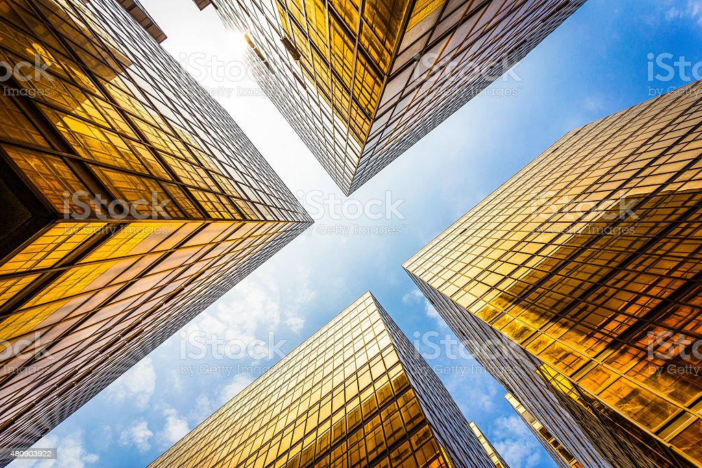 low angle view of modern skyscraper exterior and sky stock photo