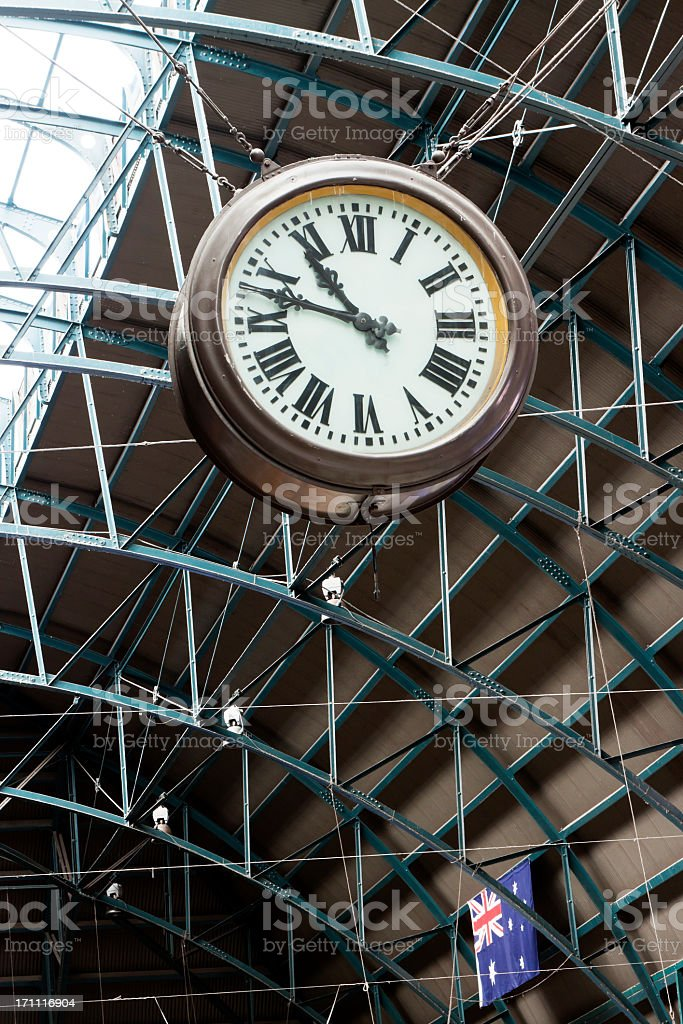 Low angle view of railway clock attached to the celing stock photo