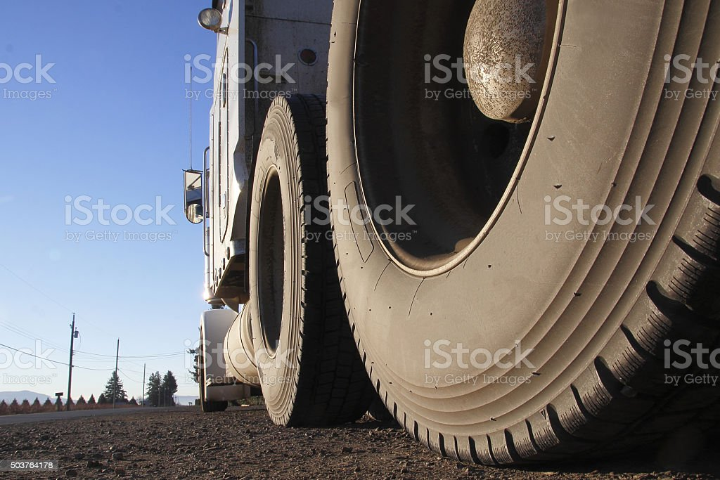 Low Angle View of Semi Trailer Tires stock photo