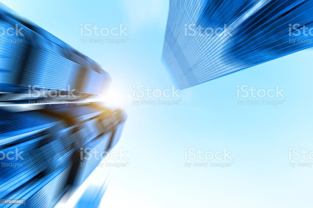 low angle view of skyscrapers in blurred motion. stock photo