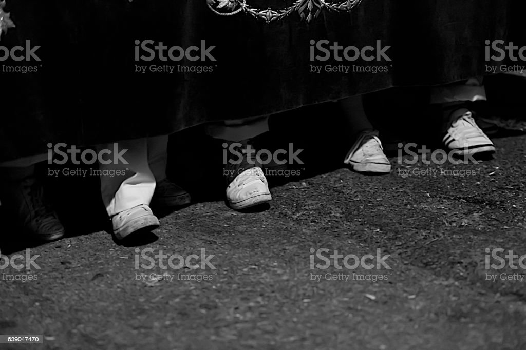 Low angle view of the feet of penitents stock photo