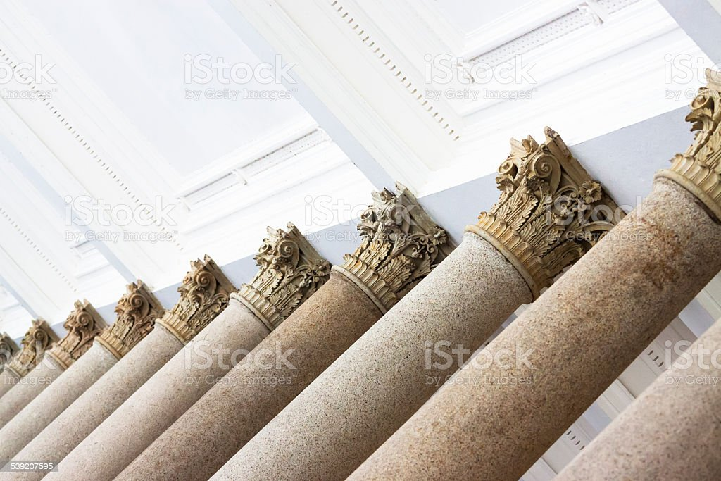 Low angle view of top part of classical columns stock photo