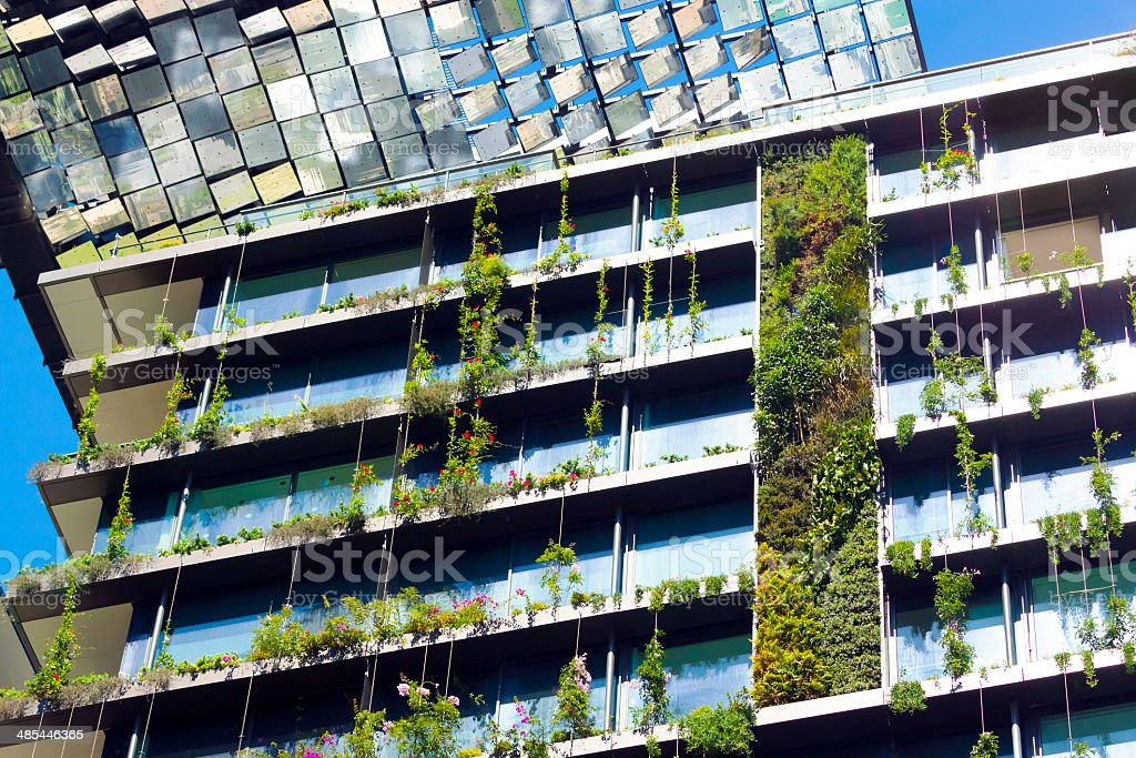 Low angle view of vertical garden and heliostat stock photo