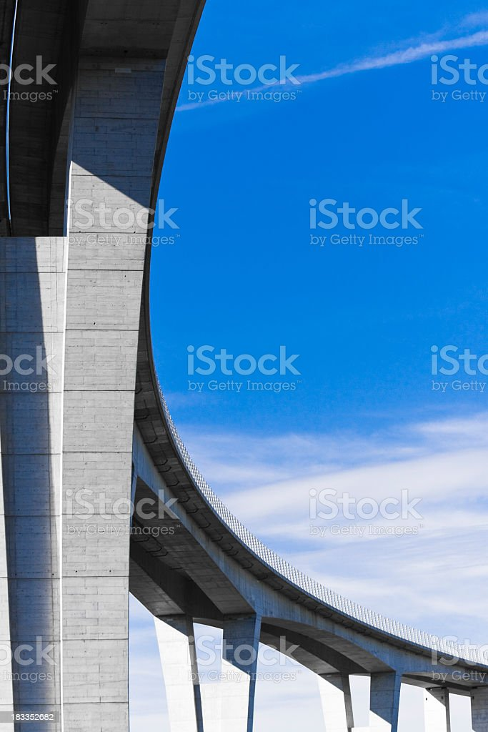 Low angle view of viaduct against bright blue sky stock photo