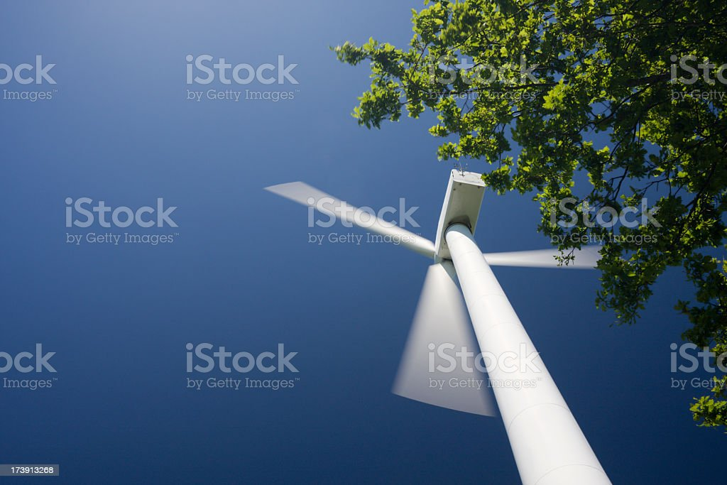Low angle view of wind turbine. Motion blur, Copy space. royalty-free stock photo