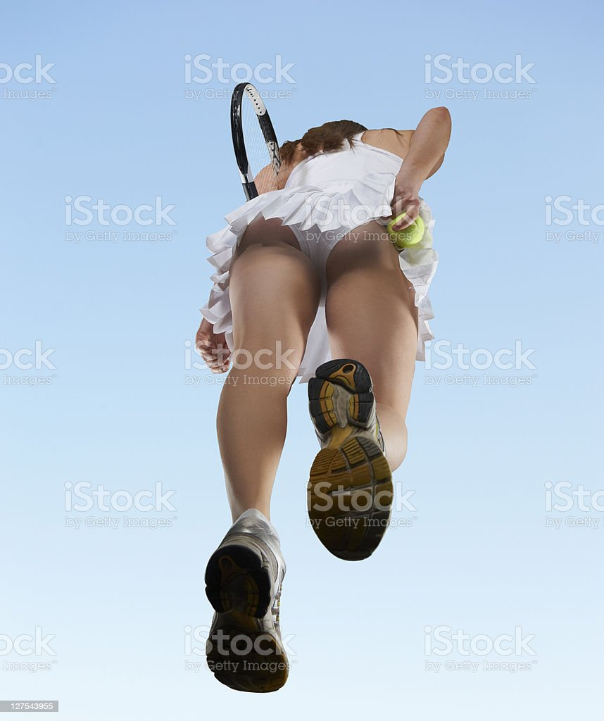 Low angle view of woman playing tennis