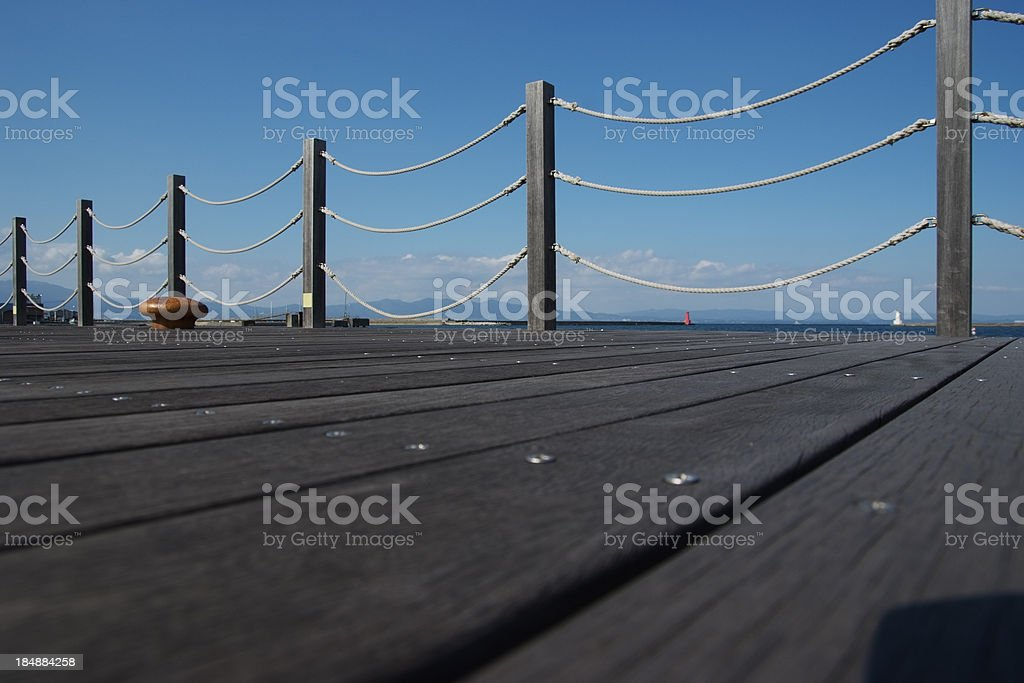 Low angle view of wooden post fence against clear sky royalty-free stock photo