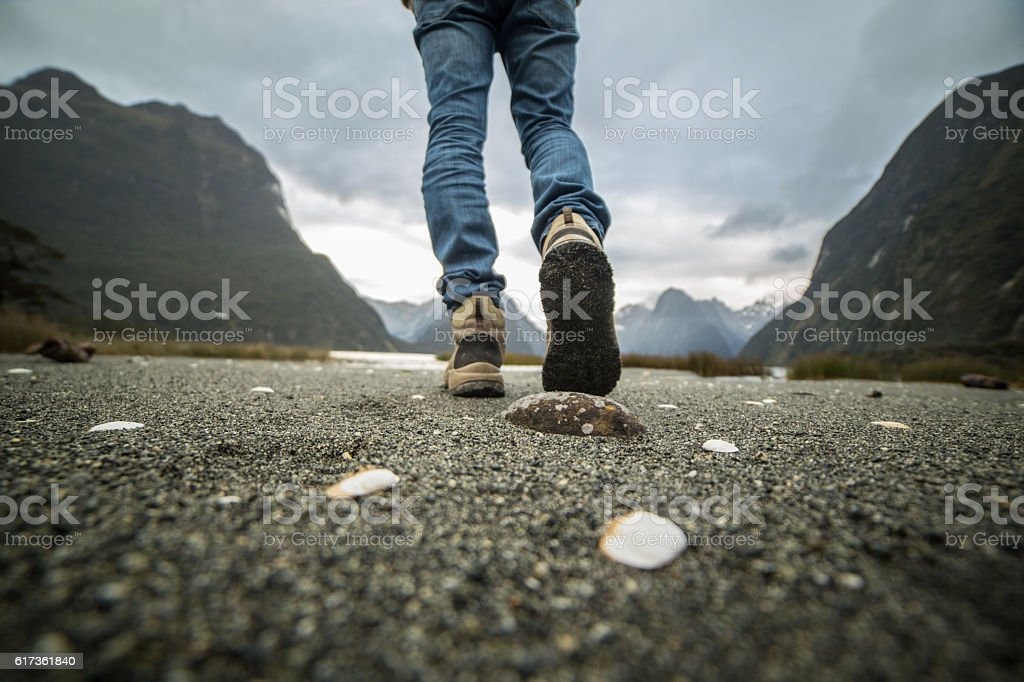 Low angle view on hiker walking on trail stock photo