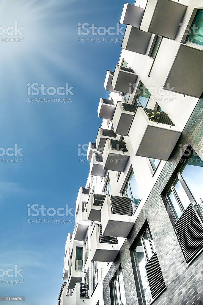 low angle view on  modern residential houses in summer berlin stock photo