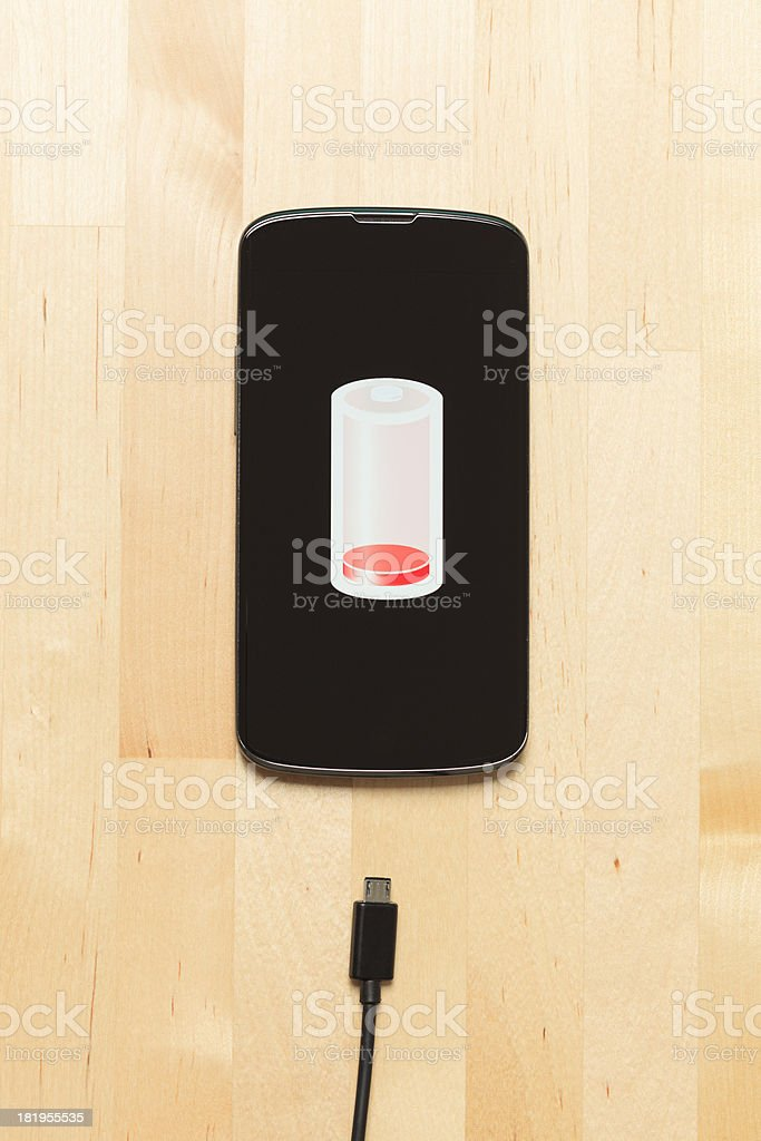 Low battery and smart phone royalty-free stock photo