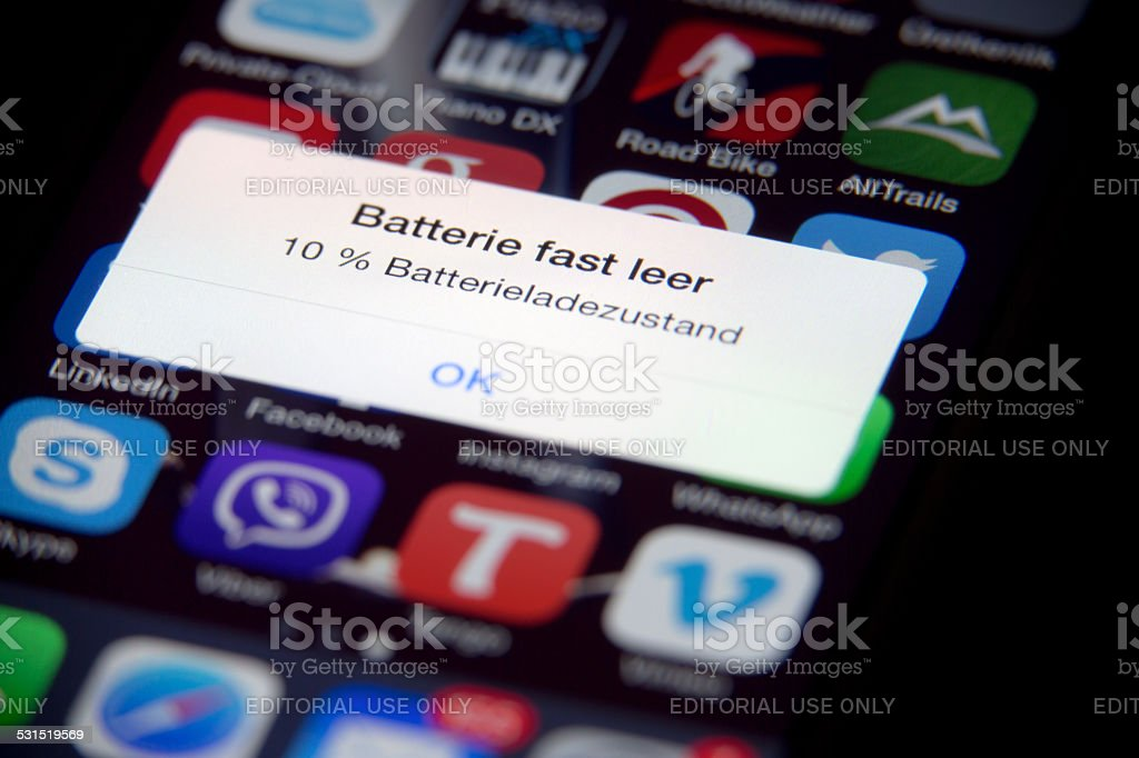 low battery Apple iPhone in german stock photo