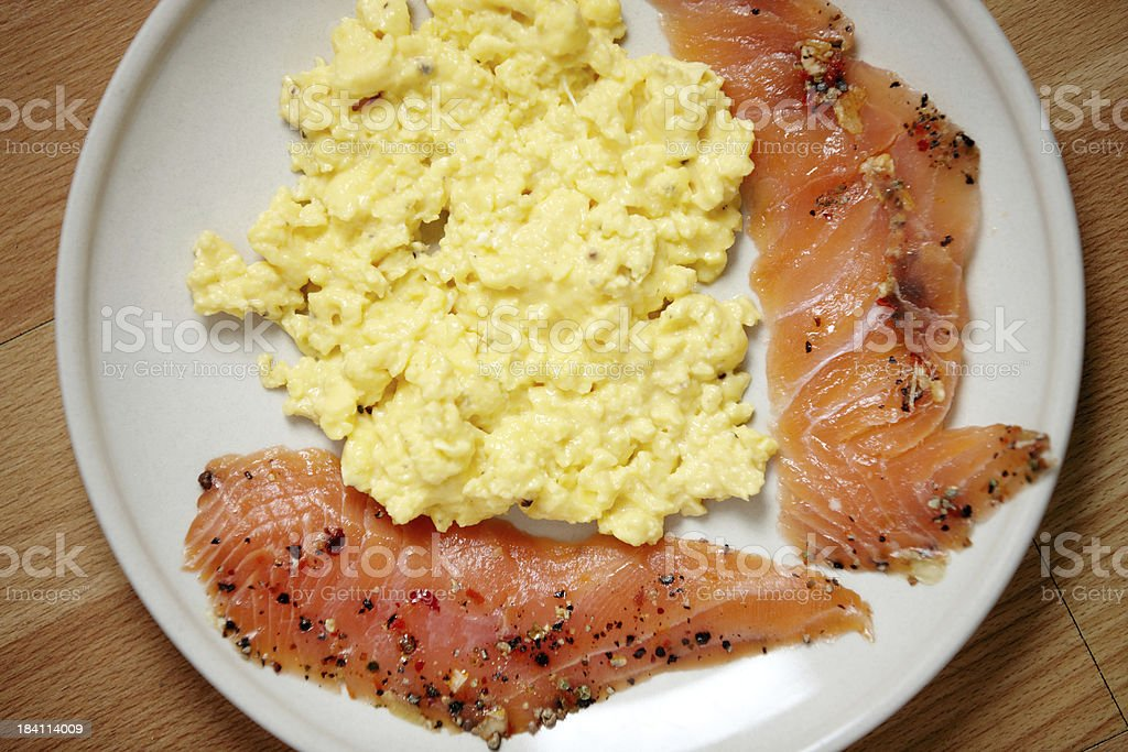 Low carb breakfast of smoked salmon and scrambled eggs stock photo