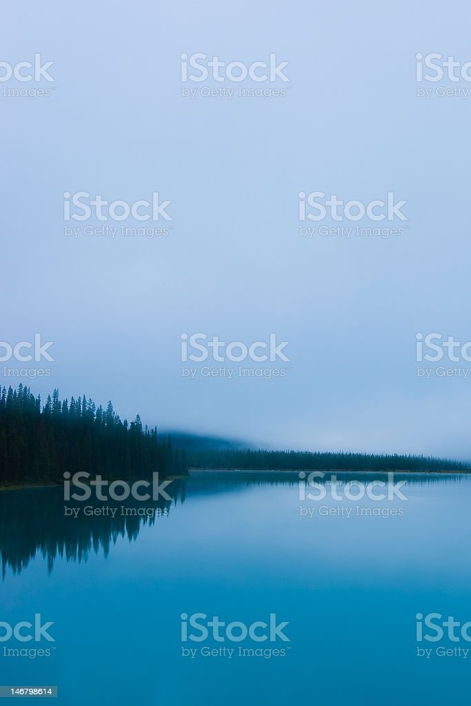 Low clouds on Emerald Lake stock photo