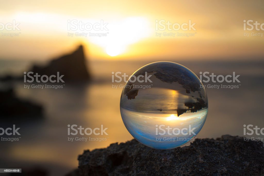 low depth of field crystal ball at sunset stock photo