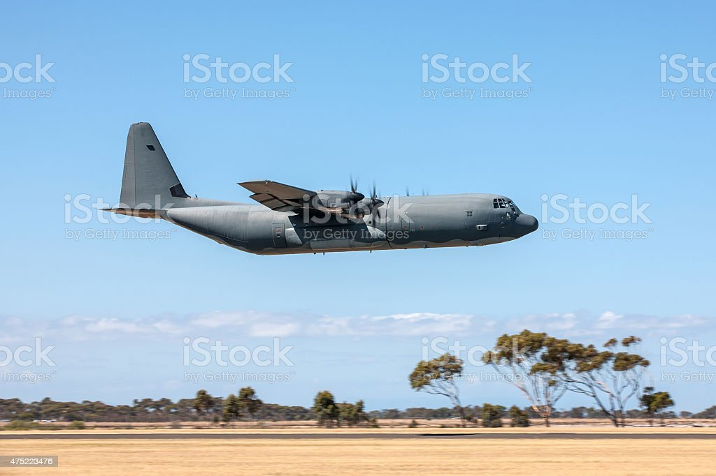 Low Flying C-130 Military transport aircraft stock photo