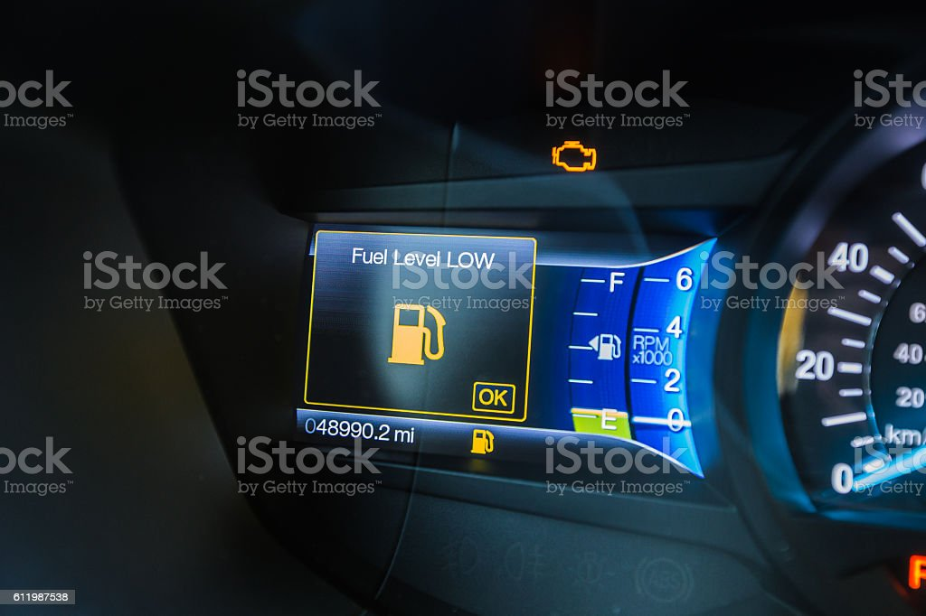 Low fuel car dashboard stock photo