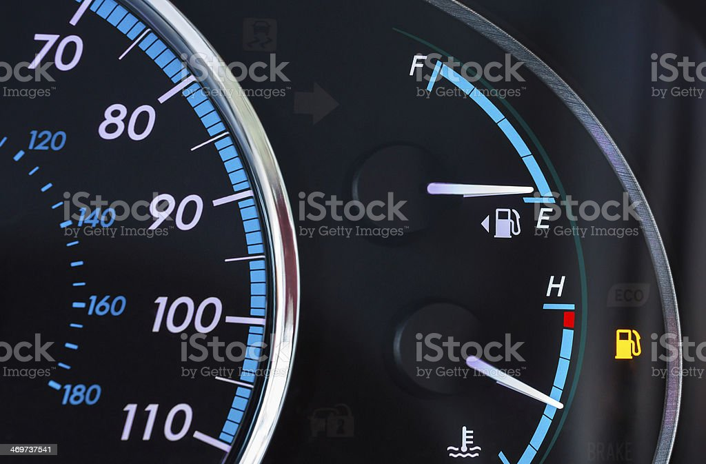Partial dashboard with fuel gauge on low