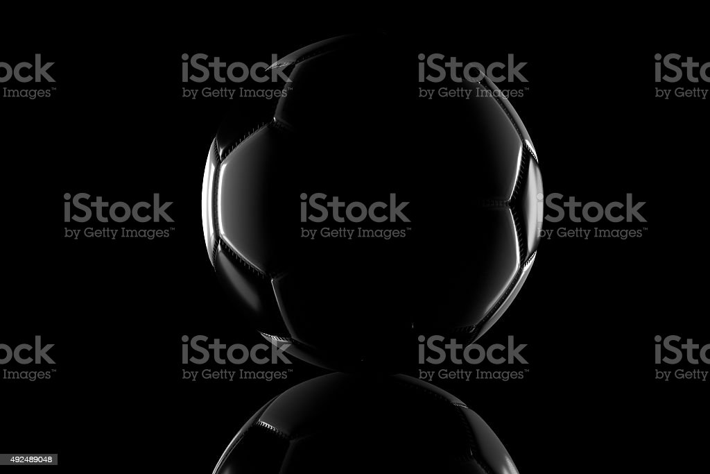 low key black and white football stock photo