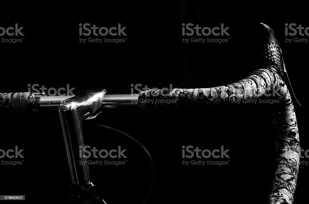 low key black and white silhouette of bicycle black background stock photo