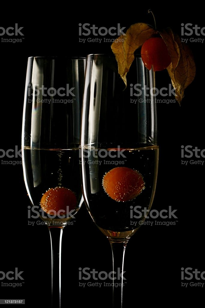 Low Key champagne glasses with fruit stock photo