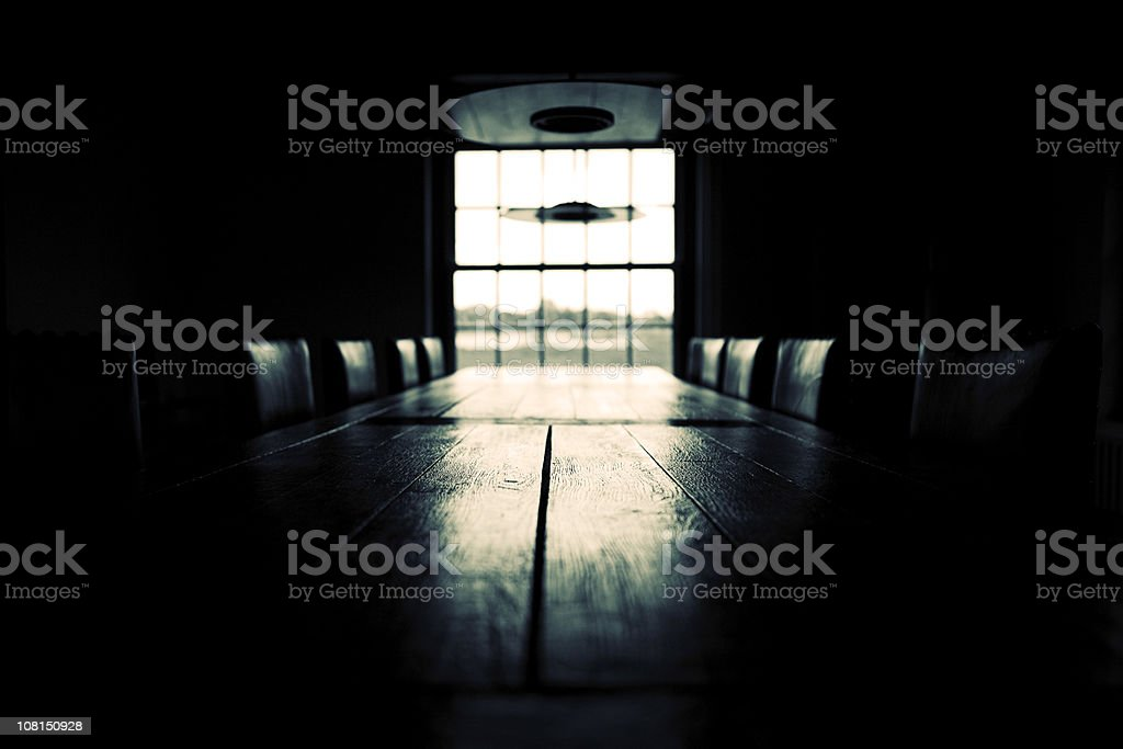 Low key empty boardroom scene; black and white stock photo