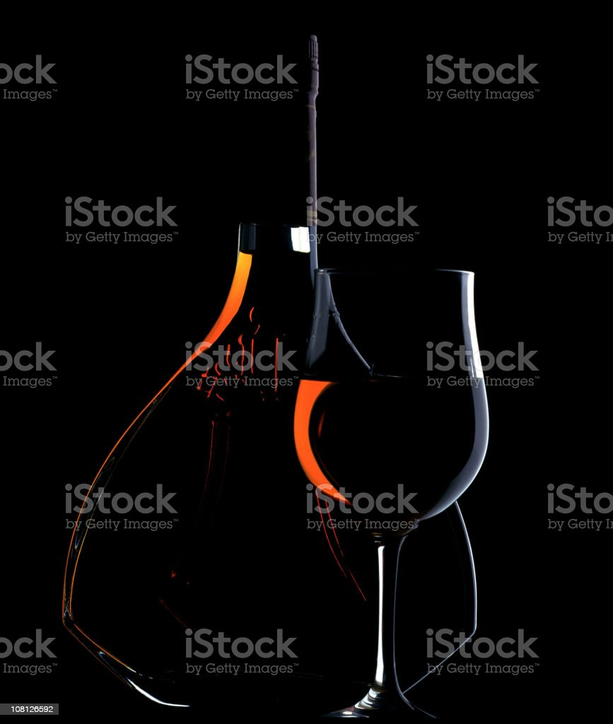 Low Key Lit Portrait of Cognac Bottle and Glass stock photo