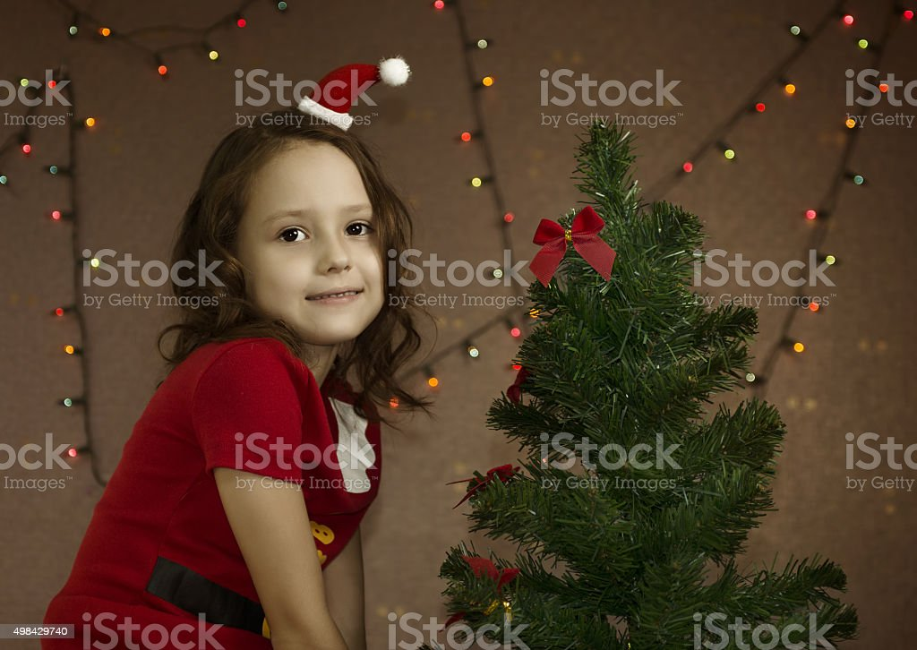 Low key photogrphy of a dwarf with christmas tree stock photo