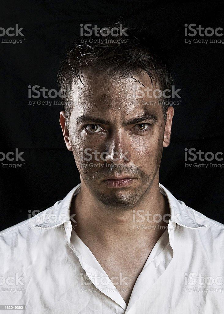 Low key portrait of dirty man stock photo
