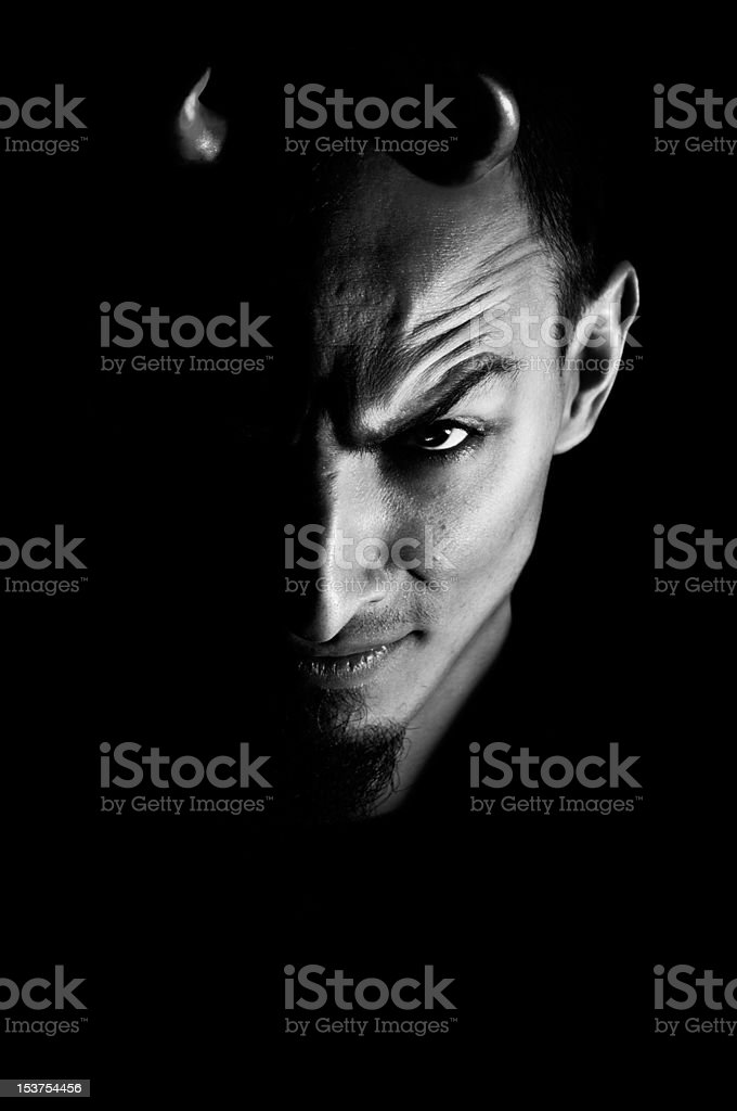 Low key portrait of evil stock photo