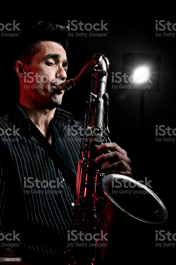 Low Key Portrait of Man Playing Saxophone stock photo