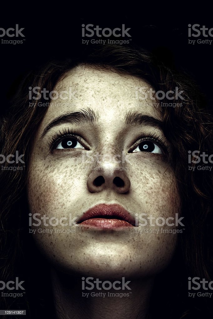 Low Key Portrait of Red Haired Woman with Freckles stock photo