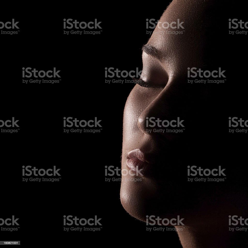 Low key portrait of sensual woman stock photo