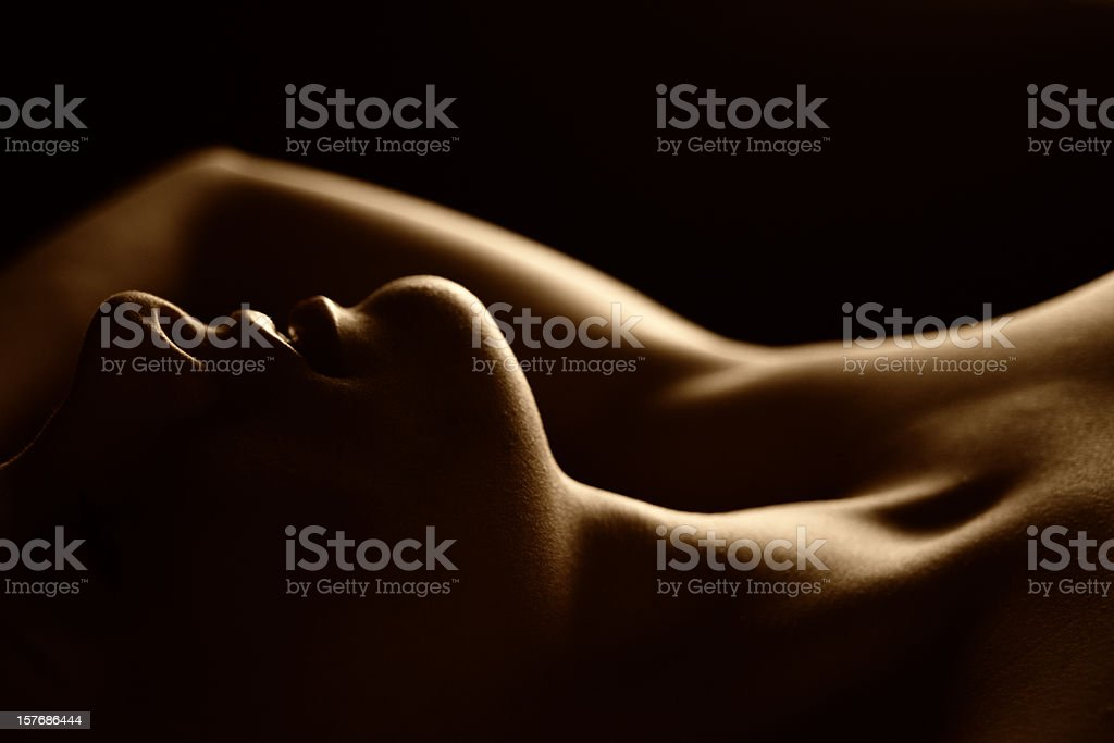 Low Key Portrait of Woman Lying Down stock photo