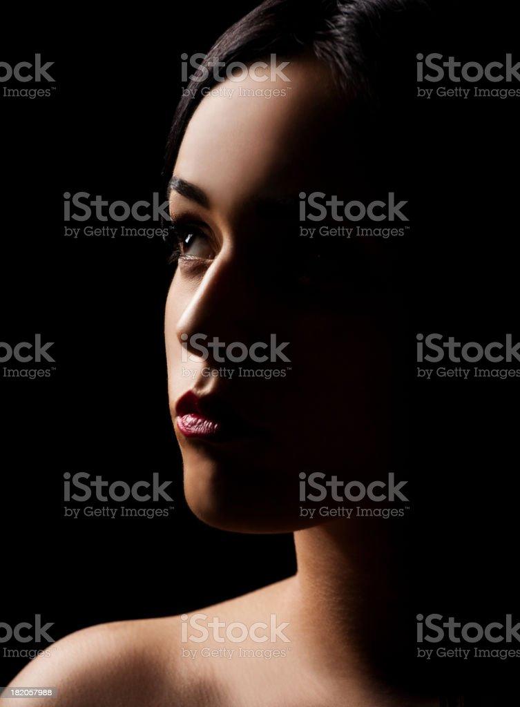 Low key portrait of women stock photo