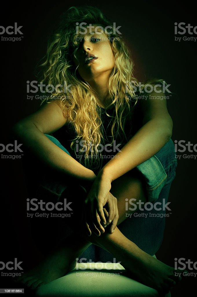 Low Key Portrait of Young Woman Posing royalty-free stock photo