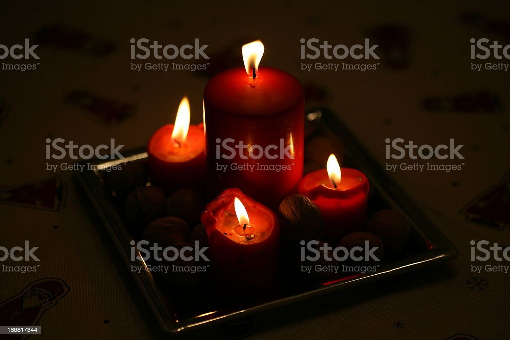 Low key shot of four burning candles royalty-free stock photo
