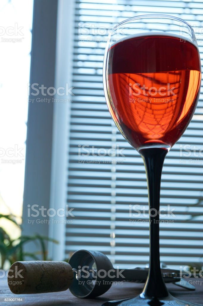low key shot of wineglass of red pink wine stock photo