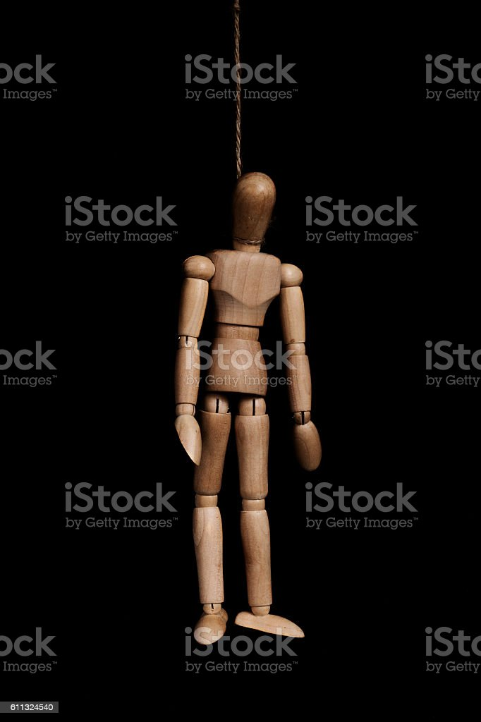 Low key, wooden figure hangman by rope, on black background stock photo