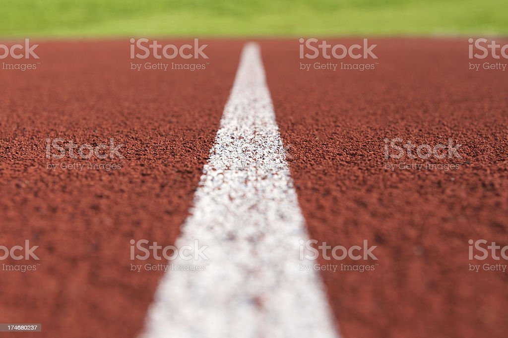 Low level close-up of the white line on a running track royalty-free stock photo