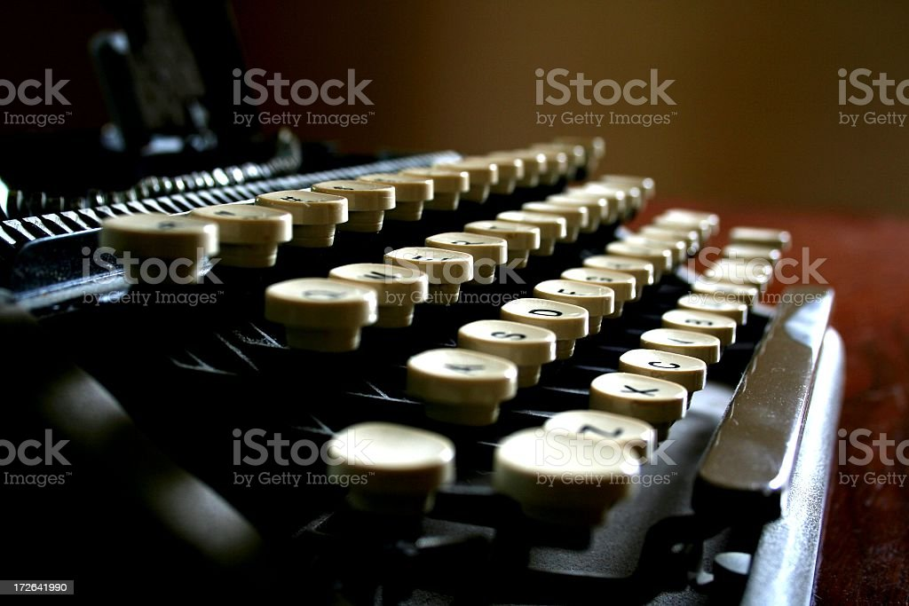 Low light close up of keys on a typewriter stock photo